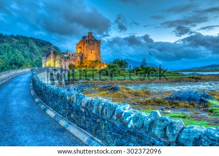 Eilean Donan Castle at night, Dornie, Kyle of Lochalsh in Scotland, United Kingdom. It is the most visited castle, situated on an island at the confluence of three sea lochs. - stock photo