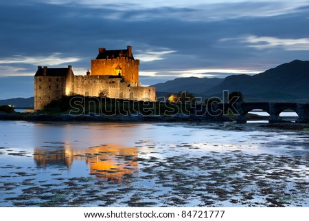 Eilean Donan Castle at twilight, Scotland, UK - stock photo