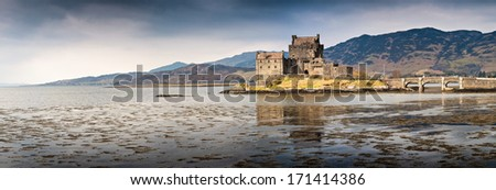 Eilean Donan castle in Loch Duich surrounded by the mountains of the Scottish Highlands. - stock photo