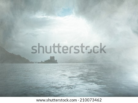 Eilean Donan castle in Scotland with fog - stock photo