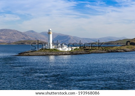 Eilean Musdile, or Mansedale, is an islet, and lighthouse to the south west of Lismore in the Inner Hebrides. - stock photo