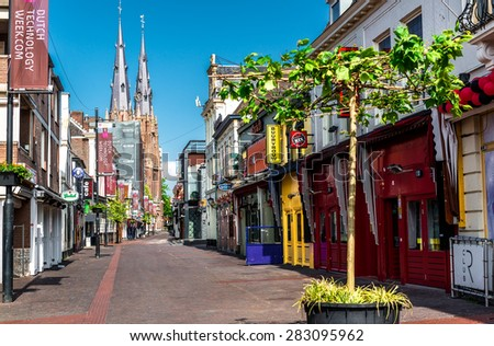Eindhoven, Netherlands - May 24, 2015: Morning in Eindhoven city center. After Dark it is one of the most visited place for tourists. Streets lined with bars, discos, gay and striptease clubs  - stock photo