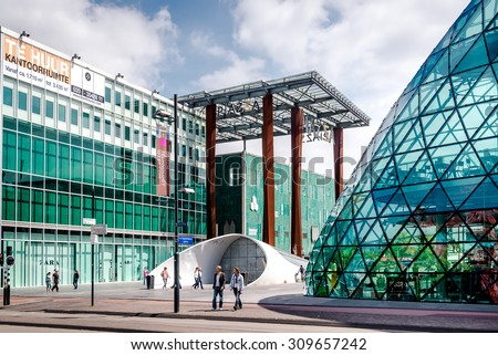 Eindhoven, Netherlands - May 24, 2015: People walking in the Eindhoven square. It is one of the most famous place in the city with plenty of restaurants, shopping centres, bars, stores and clubs - stock photo