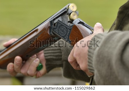ejecting a spent carttridge from a shotgun - stock photo
