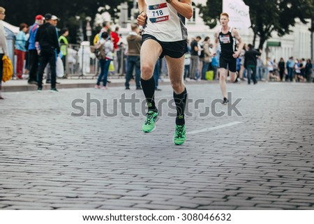 Ekaterinburg, Russia - August 01, 2015: closeup of feet of a runner man running on a city street during Marathon From Europe To Asia - stock photo