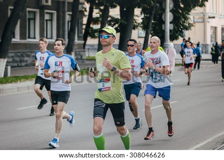 Ekaterinburg, Russia - August 01, 2015: male athlete running during Marathon From Europe To Asia, Ekaterinburg, Russia - August 01, 2015 - stock photo