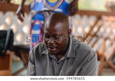 EKPA, BENIN - JAN 12, 2017: Unidentified Benin man works as a headmaster of the school of predictions in Ekpa village, one of the local touristic attractions