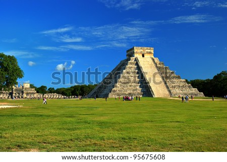 El Castillo (Pyramid of Kukulcan) in Chichen Itza, Quintana Roo, Mexico. Mayan ruins  near Cancun considered one of the seven wonders of the world. The Temple of Warriors is in the background. - stock photo