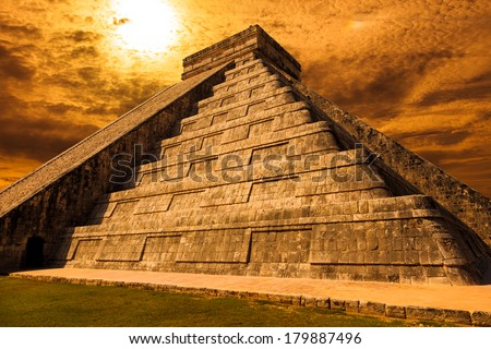 El Castillo (The Kukulkan Temple) of Chichen Itza complex at sunset, mayan pyramid in Yucatan , Mexico - stock photo