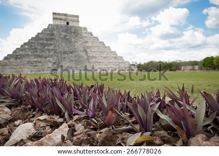 """El Castillo (The Kukulkan Temple) of Chichen Itza, mayan pyramid in Yucatan, Mexico. The Maya name """"Chich'en Itza"""" means """"At the mouth of the well of the Itza.""""  - stock photo"""