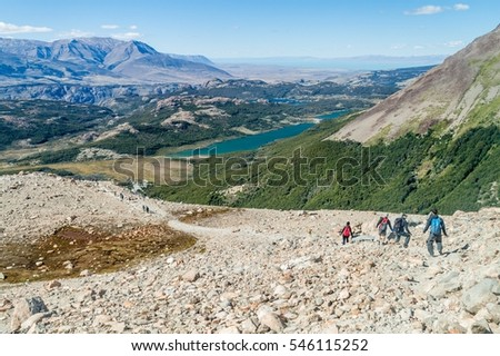 EL CHALTEN, ARGENTINA - MARCH 11, 2015: Tourists hiking near Laguna de los Tres lake in National Park Los Glaciares, Patagonia, Argentina