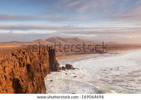 el cotillo beach in fuerteventura island on sunset - stock photo