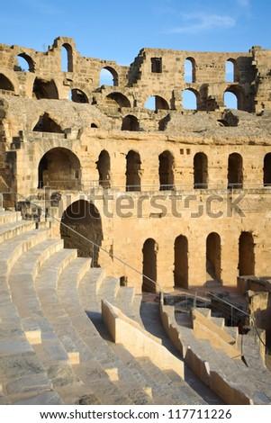 El Djem Amphitheatre auditorium. Arches and auditorium of roman biggest amphitheater in africa in El Djam, Tunisia - stock photo