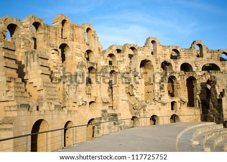 El Djem, Amphitheatre walls. Arches of roman biggest amphitheater in africa in El Djam, Tunisia - stock photo