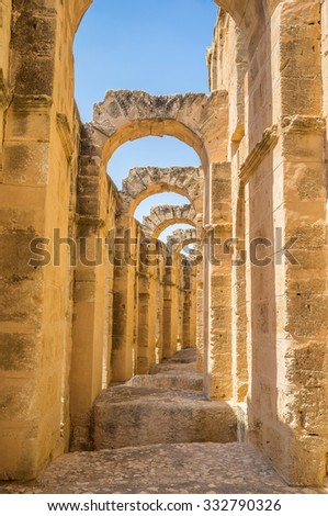 EL JEM, TUNISIA - SEPTEMBER 1, 2015: Nowadays tourists enjoy the ancient Roman amphitheatre, that serves as the archaeological museum, on September 1, in El Jem. - stock photo
