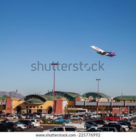 EL PASO  OCTOBER 24.  FedEx departs the El Paso International Airport on the way to Memphis on October 24, 2014 at El Paso, Texas.  - stock photo