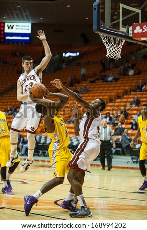 EL PASO, TEXAS - DECEMBER 28.  Denver�s Bret Olson (23) in the air trying to block Alcon State's Marquis Vance (30) shot in the Invitational Tournament on December 28, 2013 in El Paso, Texas.    - stock photo
