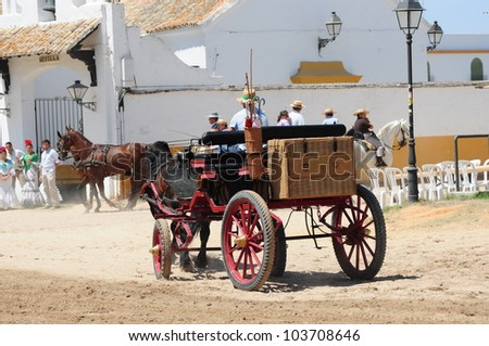 EL ROCIO, ANDALUSIA, SPAIN - MAY 27: People attend traditional pilgrimage - Romeria in el Rocio on May 27, 2012 in El Rocio, Andalusia, Spain.
