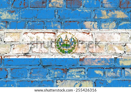 El Salvador flag painted on old brick wall texture background - stock photo