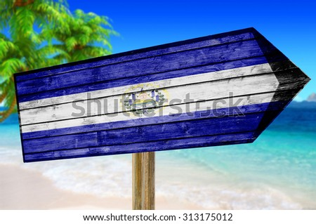 El Salvador Flag wooden sign on beach background - stock photo