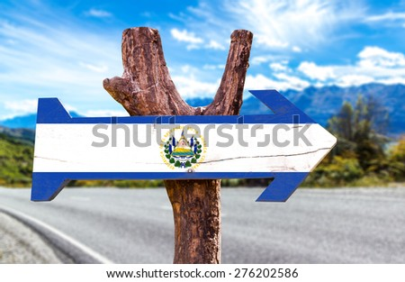 El Salvador Flag wooden sign with road background - stock photo