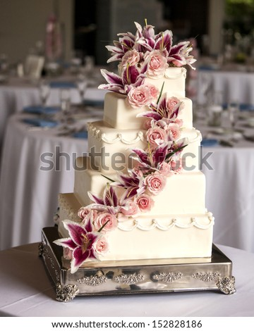 elaborate five tiered wedding cake with flowers - stock photo