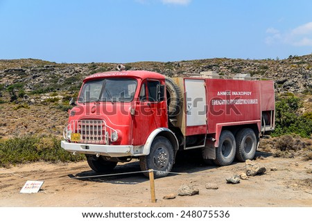 ELAFONISI, GREECE - AUGUST 17: Old  red fire truck at Elafonisi on August 17, 2013 in Elafonisi, Crete island, Greece - stock photo