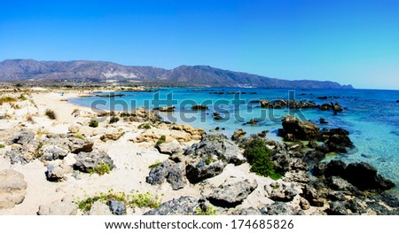"Elafonisi or Elafonissi, ""deer island"" in Greek, is an island with turquoise water in the southwestern corner of the Mediterranean island of Crete, Greece. The island is a protected nature reserve."