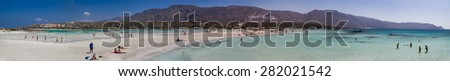 ELAFONISSI, CRETE, GREECE - August 24, 2014: Tourists At The Famous Pink Sand Beach Of Elafonissi ( Elafonisi ) In Crete, Greece - stock photo