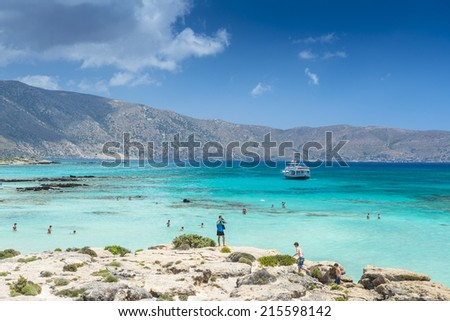 ELAFONISSI, CRETE, GREECE - July 24, 2014: Tourists At The Famous Pink Sand Beach Of Elafonissi ( Elafonisi ) In Crete, Greece - stock photo
