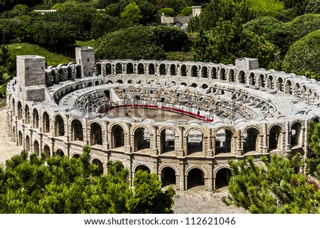 ELANCOURT - JULY 22 : France Miniature - 116 of most spectacular monuments of French national heritage, all modeled on a 1:30 scale, in Elancourt, France on July 22,2012. Arles Arena.