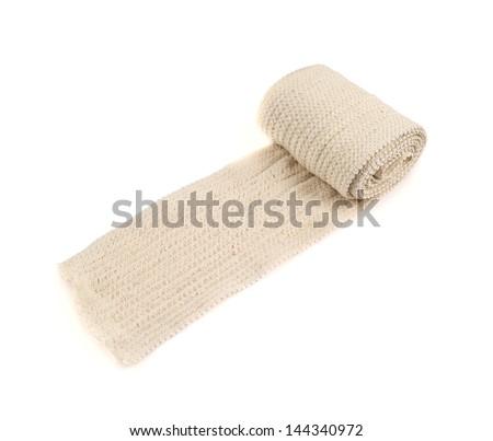 Elastic ACE compression bandage warp unwrapped, isolated over white background - stock photo