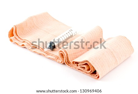 Elastic Bandage  and Plastic Syringe on white background - stock photo