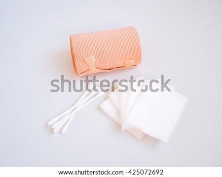 Elastic bandage,cotton bud and cotton sheets isolated on white background - stock photo