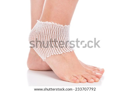 Elastic bandage on the ankle. Sprain.