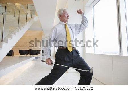 Elated businessman - stock photo