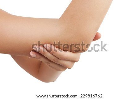 Elbow pain. Beautiful female holding her elbow. Pain concept. - stock photo