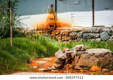 ELBRUS REGION - July 10: Glade of Narzan. Carbonated mineral water from a sources in the forest, Kabardino-Balkar Republic in July 10, 2015 in  Elbrus region, Russia.  Focus on bottom source - stock photo