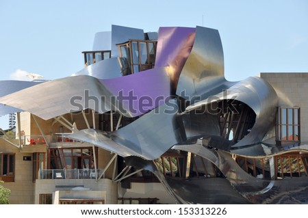 ELCIEGO, SPAIN - MAY 26: The modern winery of Marques de Riscal on May 26, 2013 in Elciego, Basque Country, Spain. This modern winery, designed by Frank Gehry, was  built in 2007. - stock photo