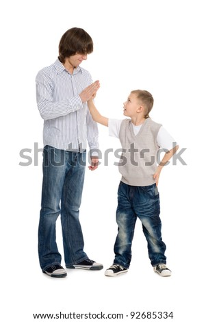 Elder and younger brothers greet each other. - stock photo