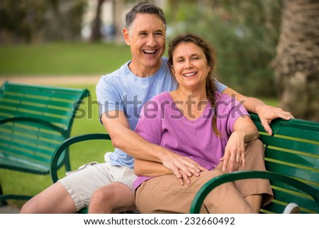 Elder couple relaxing at the park - stock photo