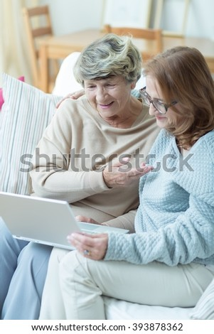 Elder lady is talking with her family via internet