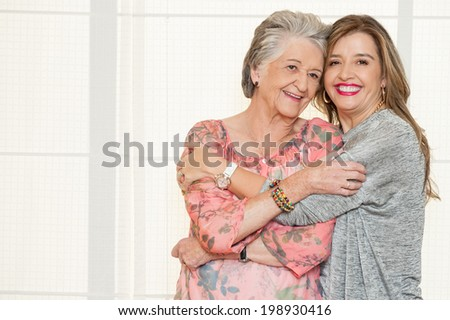 Elder mother and daughter - stock photo