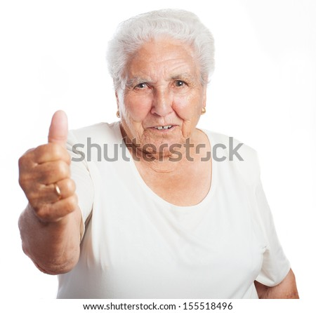 elder woman doing good symbol on a white background - stock photo