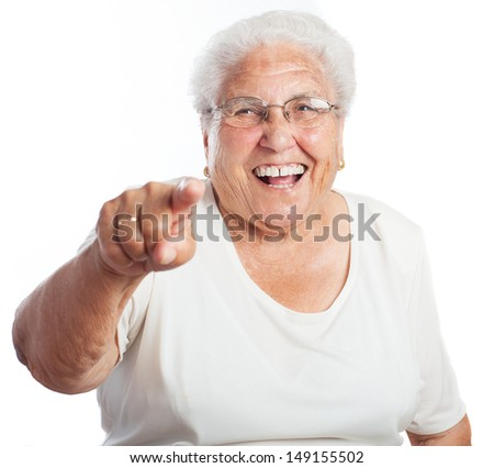 elder woman pointing on a white background - stock photo