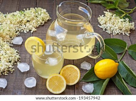 elderberry flower flavored summer refreshment cocktail with sliced lemon - stock photo