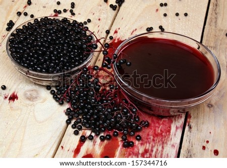 Elderberry fruits herb on the table - stock photo