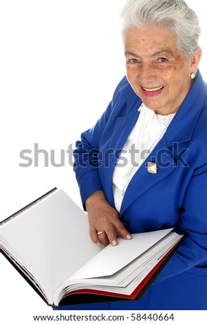 Elderly adorable woman smile with the book - stock photo