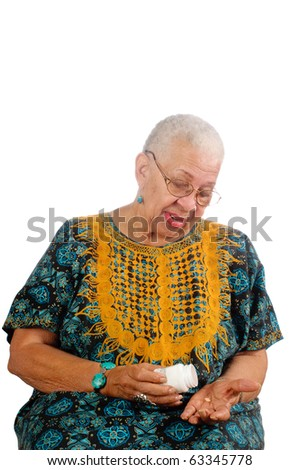 Elderly African American woman pouring her pills from a container into her hand