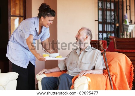 elderly and nurse or carer - stock photo